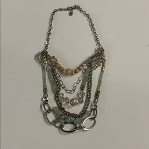 Mutual stone, glass, metal necklace.